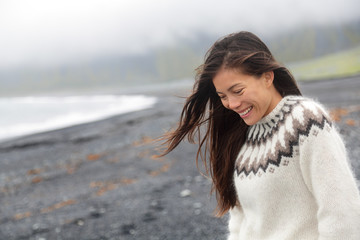 Cute woman walking on beach on Iceland