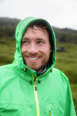 Rain jacket - man smiling outdoors on rainy day