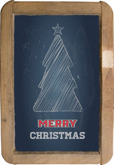 Christmas greeting, little blackboard and chalk on black backgro