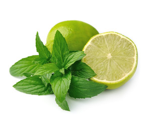 Fresh citrus lime with mint close up on white background
