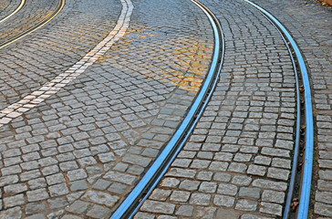 Road with tiled floor and tram lines