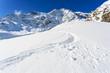 Winter mountains, ski run in Italian Alps