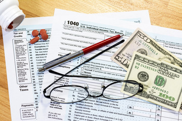 Eyeglasses on your tax forms needing filled out