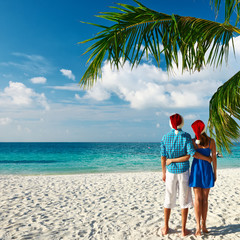 Couple in blue clothes on a beach at christmas