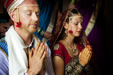 Western couple getting married in an Indian ceremony