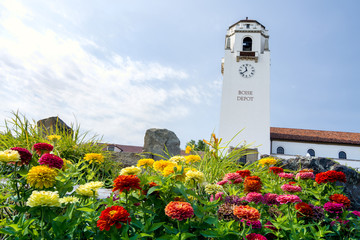 Train depot tower and summer flowers