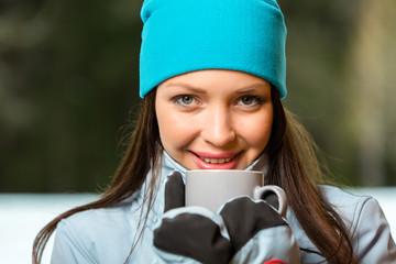 Portrait of female drinking hot tea outdoors