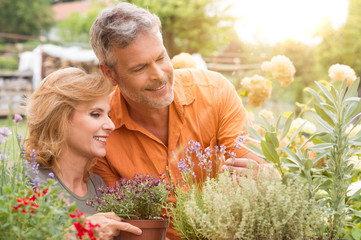 Happy Mature Couple Gardening