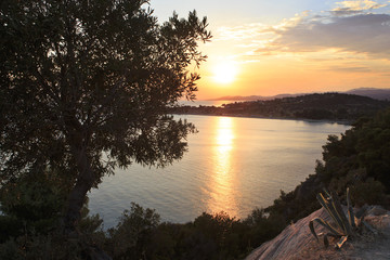 Picturesque sunset in the Bay of the Aegean Sea.