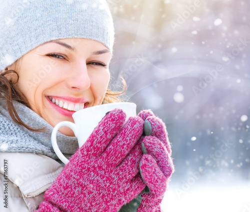 canvas print picture Beautiful happy smiling winter woman with hot drink outdoor