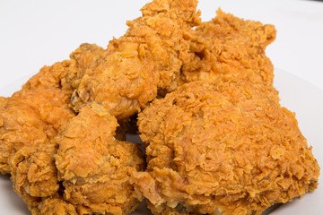 Closeup of Fried Chicken on White