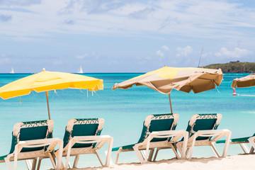 Sun Umbrellas Over Green Chairs on Beach