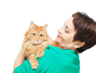 attractive emotional woman 50 years old with red cat isolated on