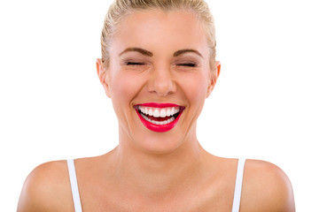 woman with beautiful teeth laughs