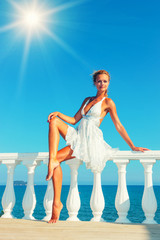 fashion model by the sea in Greece