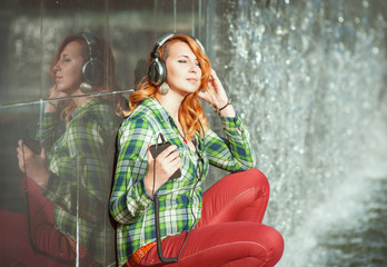 Hipster girl with headphones listening music
