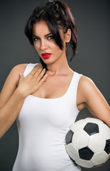 Attractive woman with soccer ball