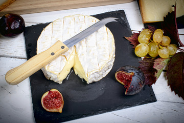 Normandy camembert with figs on a slate