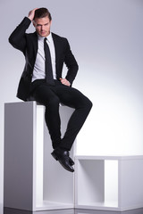 business man sitting on a modern white furniture