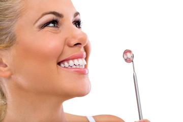 woman teeth and a dentist mirror