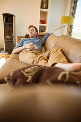 Young man napping on his couch