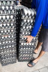 Worker life sort egg panel in wholesale market on truck