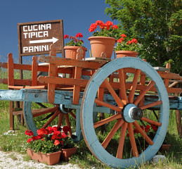 wooden colorful cart inviting to the italian restaurant