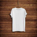 White t-shirt on wood wall