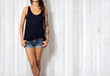 Woman wearing black sleeveless t-shirt - 71168138