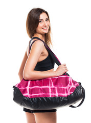 Portrait of attractive caucasian smiling woman with sports bag