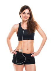 Beautiful slim woman listening to music while exercising