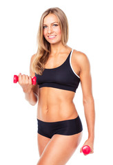 Beautiful slim woman with dumbbells, isolated on white