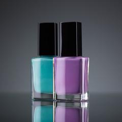 Lilac and green nail polish on black