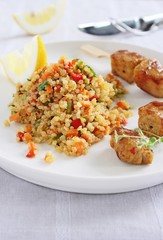 Quinoa salad with vegetables and roasted meat
