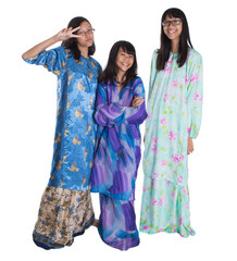 Malay teenage sisters in traditional attire