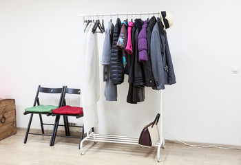 Floor rack with outerwear in the interior hallway room, nobody