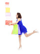 beautiful young woman holding shopping bag and gift boxes