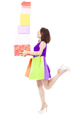 young woman holding shopping bag and gift boxes over white