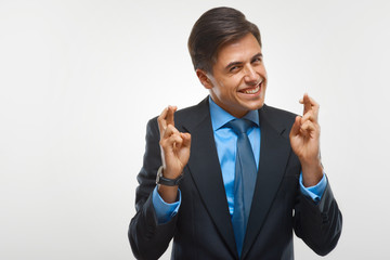 Portrait of happy businessman against white background