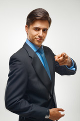 Businessman pointing at you.