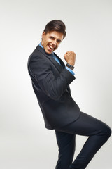 Business Man Celebrating Success against White Background