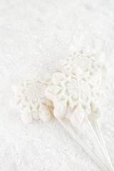 marshmallow lolly snowflake on white festive backround