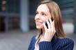 Smiling business woman talking on her mobile phone