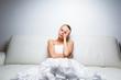 Sad bride crying sitting on a sofa - 71171379