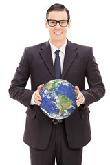 Young businessman holding the world
