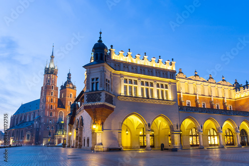 Sukiennice and St. Mary's Church at night in Krakow, Poland. - 71172755
