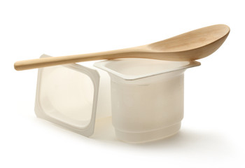 Empty yogurt pots with wooden spoon
