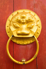 Golden Chinese door knocker