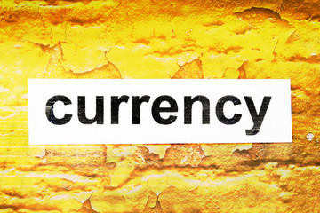 Currency text on grunge background