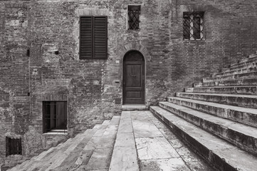 Classic Door, Windows,Wall and Staircase in Siena, Italy